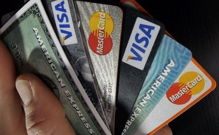 6 credit cards mastercard visa and american express in hand