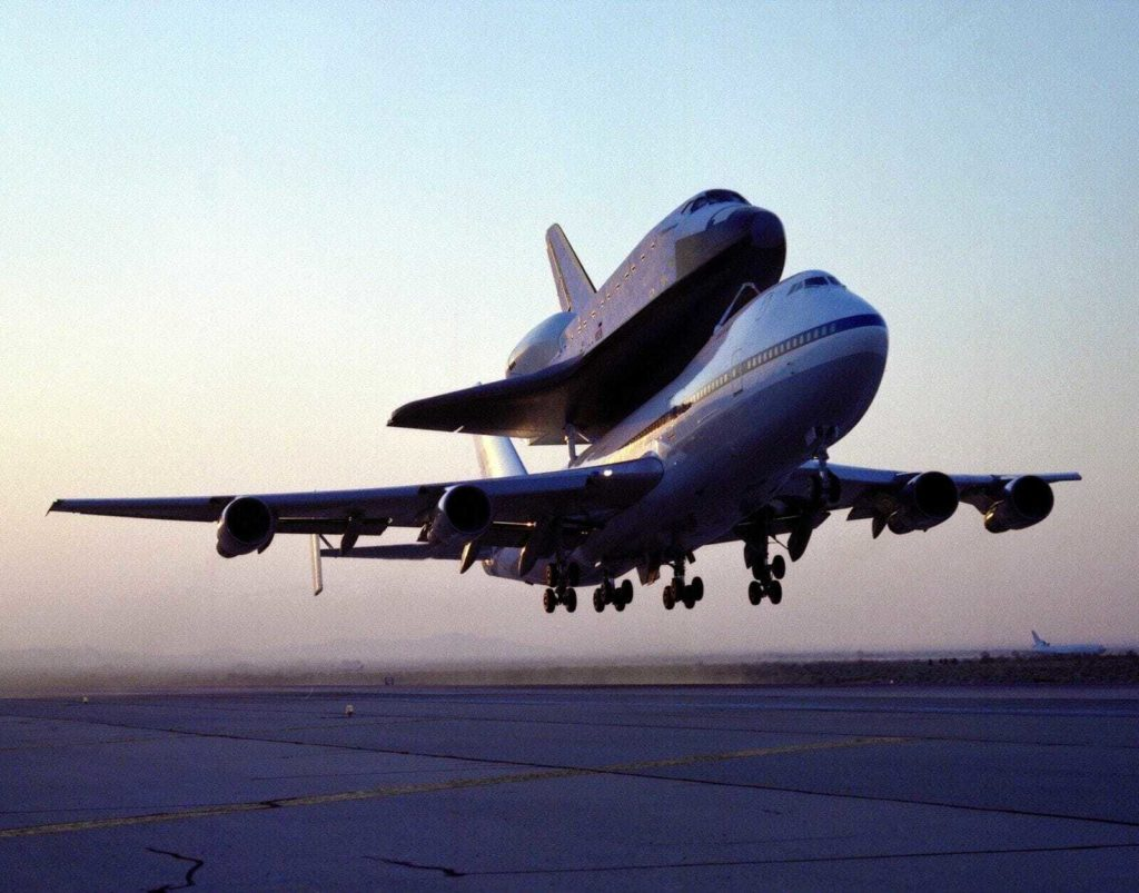 shuttle endeavour mated to 747 sca takeoff for delivery to kennedy space center florida